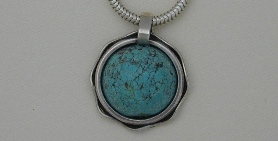 Pendant- Natural turquoise set in ornate sterling bezel