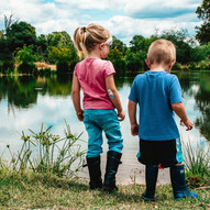 two kids by the river
