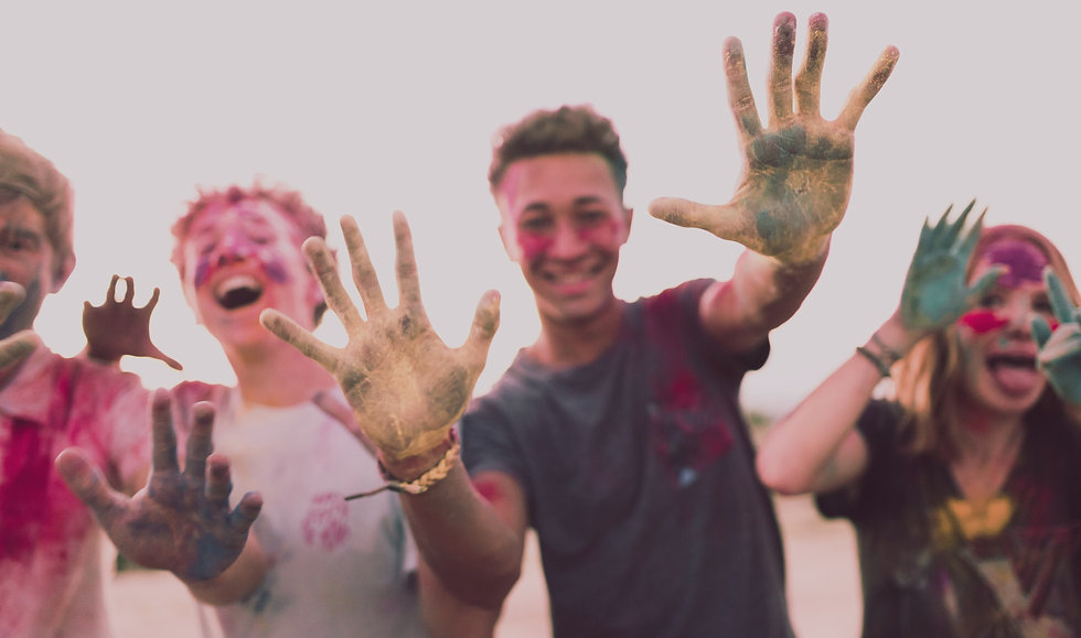 Happy students with paint on their hands