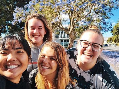 four girl smiling_jessica-wilson-nx3N6en