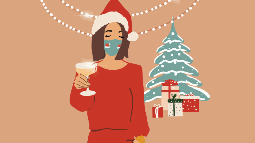 Sad looking woman wearing a face mask next to a christmas tree