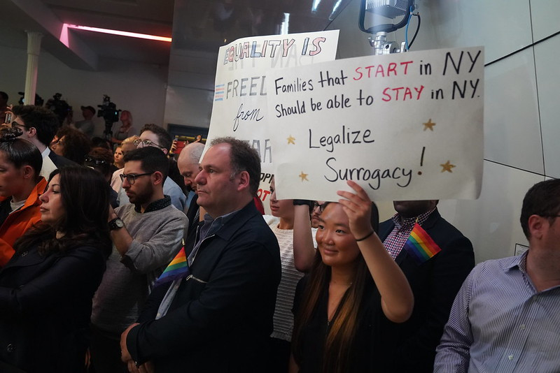 People holding placards demanding legalization of surrogacy in NY