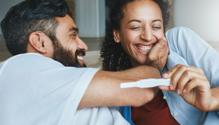 couple excited about pregnancy test result