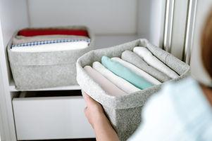 Woman organizing clothes in wardrobe, pu