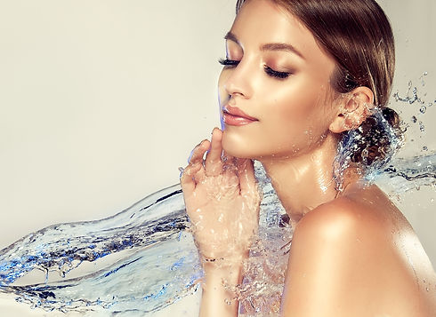 Beautiful spa woman with water splashes.