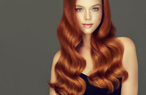Young, red haired woman with voluminous