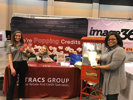 Throwback: Poppin' Credits with TRACS Group