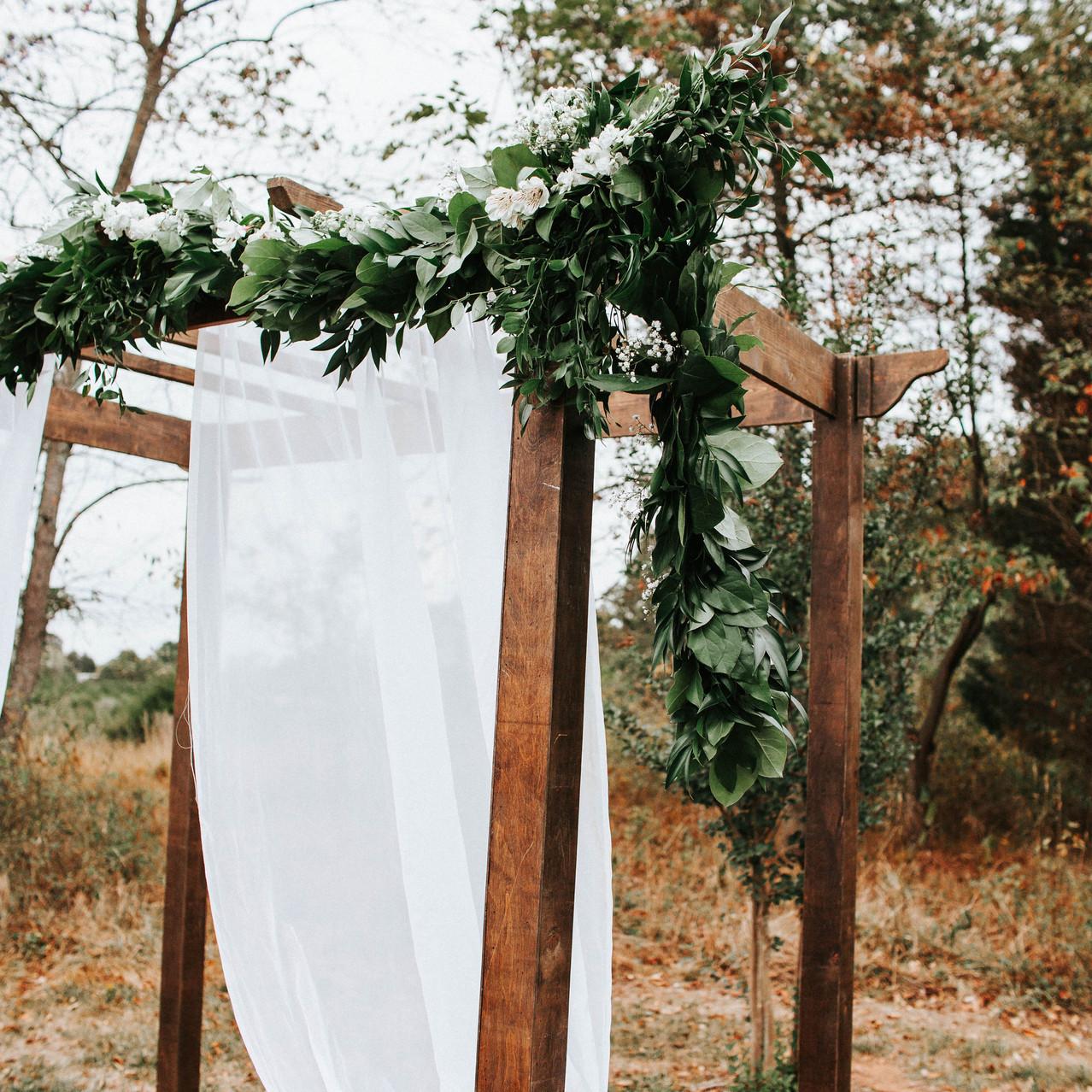 Wedding Altar with Sheer Drape and Greenery