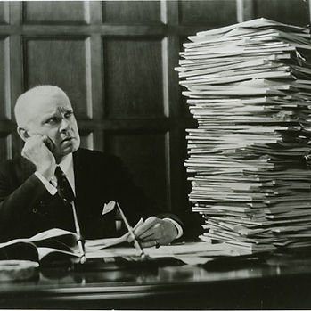 ibm.man_looking_at_stack_of_papers.10264