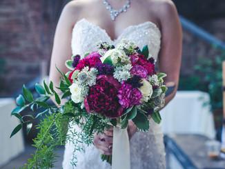 Rich deep toned bouquet by Petals & Moss