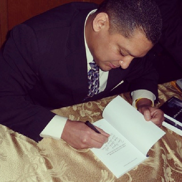 Signing one of books in Seattle Univ