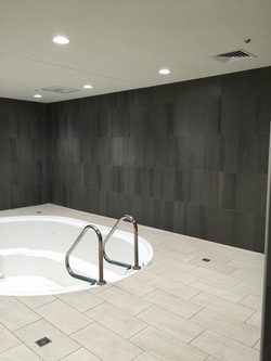 Jacuzzi room with tile