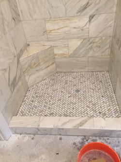 Ceramic installation in shower