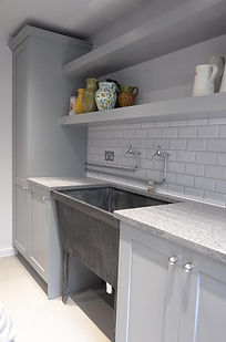 Hand fabricated custom brushed and waxed zinc sink unit for modern interior.
