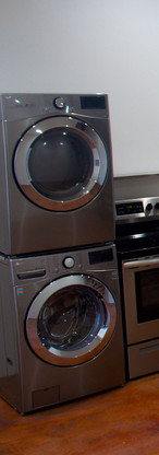 Effecient, full sized, space saving, stackable washer and dryer