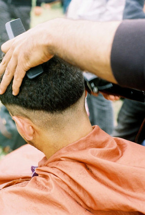 4. A man from Egypt being given a hair cut (2019)