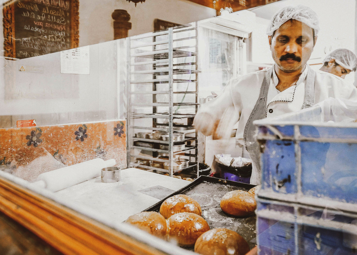 A baker preparing fresh bread at the bakery of Jimmy Boy situated near Horniman Circle. Jimmy Boy was established in the 1920's as Cafe India. The cafe was converted to a restaurant and renamed in 1999 after the current owner's great-grandfather Jamshed Irani, fondly known as Jimmy. Jimmy Boy is a cosy Irani cafe with a bakery and a takeaway counter serving the fast-paced corporate executives and lawyers at Fort.