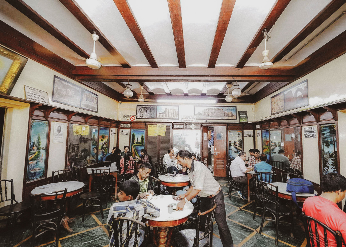 A regular day at Sassanian Boulangerie. As you step into the cafe, you can witness a showcase of pudding, cakes and bakery items, which are baked freshly everyday from five in the morning.