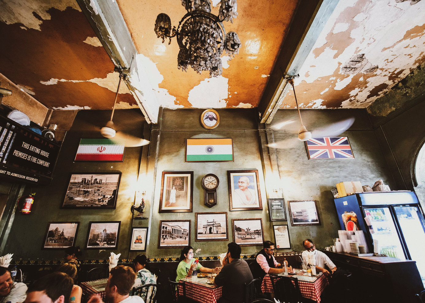 Flags of India, England and Iran adorn the top of the wall of Britannia & Co. The interior decor of the cafe pays tribute to the three countries. Hence, old images of Bombay and Persopolis (the ancient capital of Persia) find place on the walls along with photographs of Mahatma Gandhi and Queen Elizabeth on either side of a vintage pendulum clock.