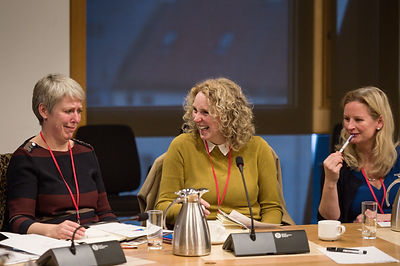women in a meeting laughing