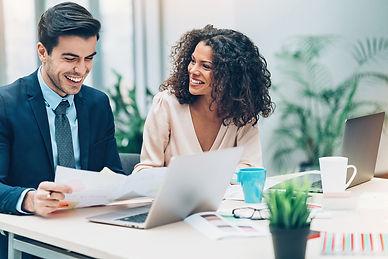man and woman at desk.jpg