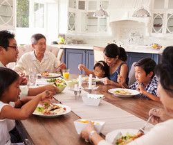 extended-family-group-eating-meal-at-hom