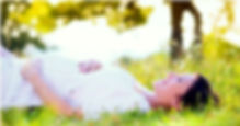 Pregnant women laying in field resized_e