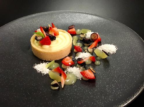 Vanilla bean tartelette with passion fruit cream and berries