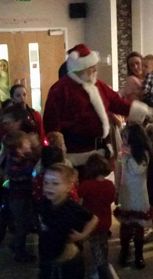 The children happy to see Santa arrive 2015