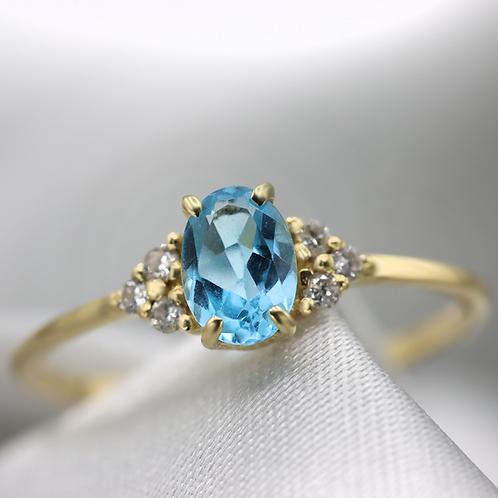 טבעת סוליטייר בלו-טופז ויהלומים