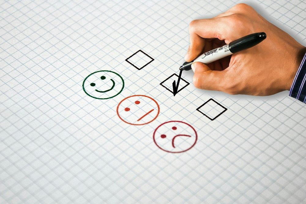Person ticking OK face in feedback form