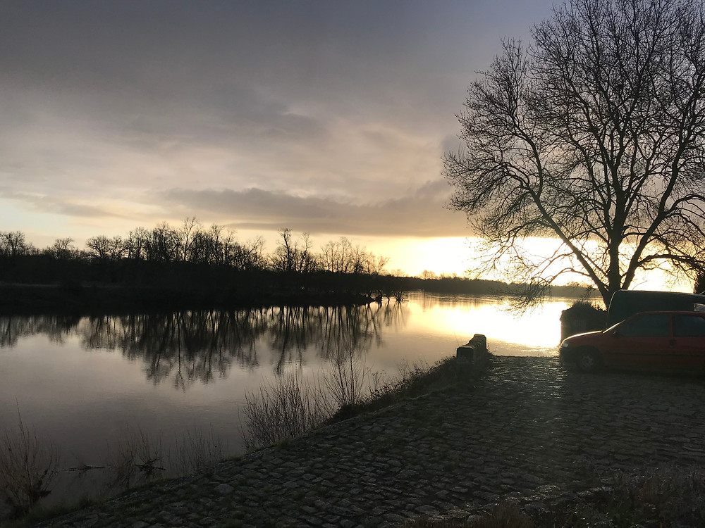 River view of house in Loire at sunset