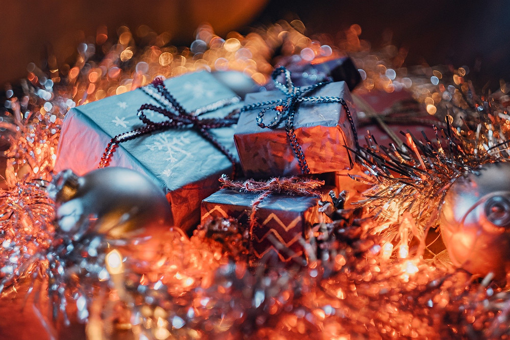 Bundle of Christmas presents in tinsel