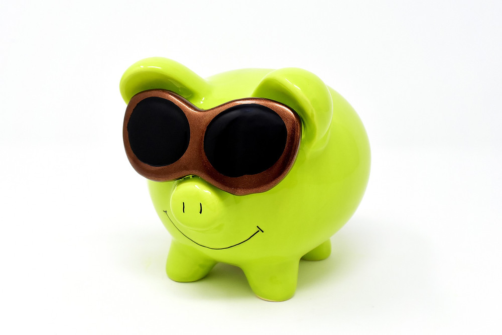 Green smiling positive cool pig statue