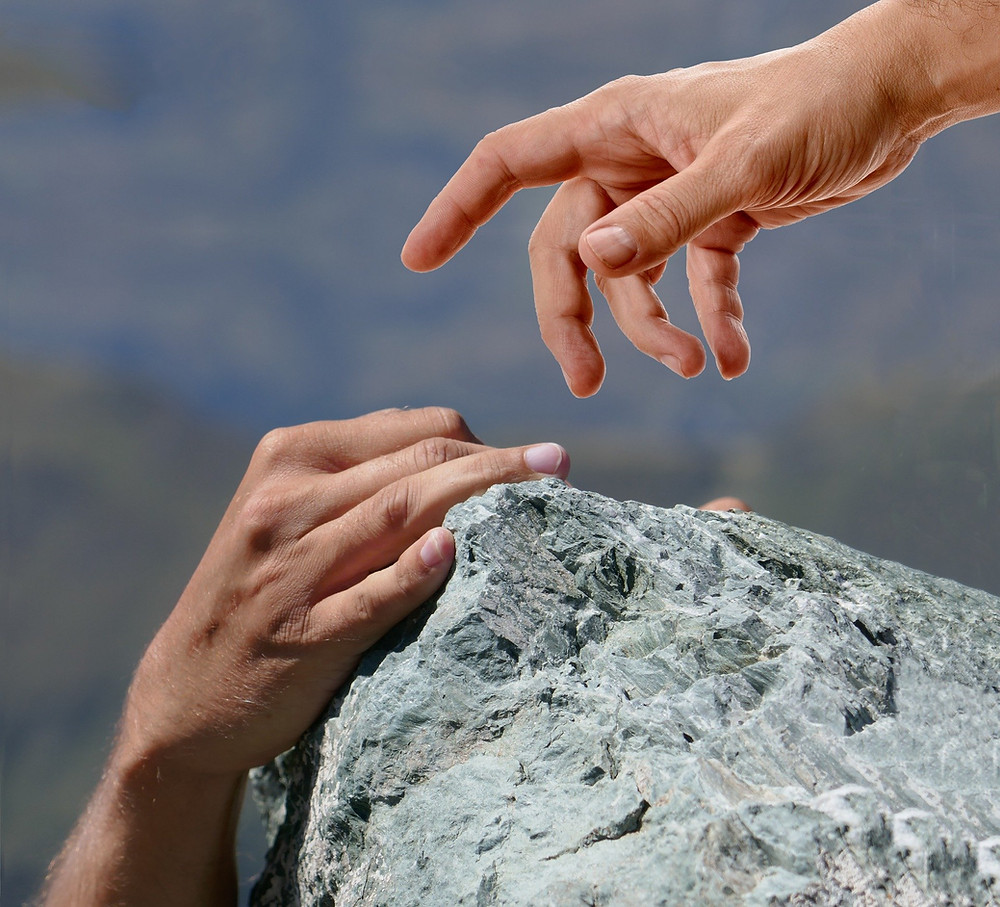 Hand helping person climb trust