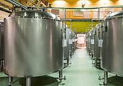 Modern Beer Factory. Rows of steel tanks