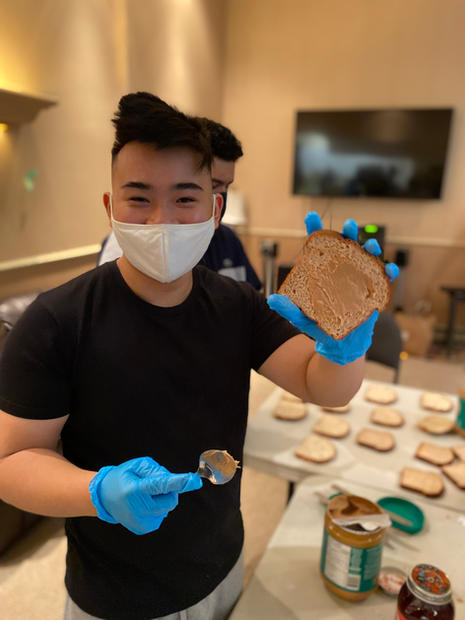 Peter Spreading PB on the bread!