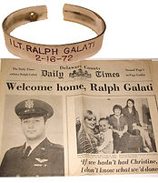 GALATI POW NEWSPAPER AND BRACELET.jpeg