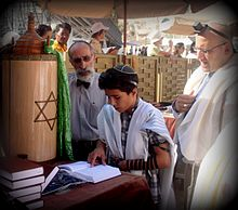 220px-Jewish_boy_reads_Bar_Mitzvah