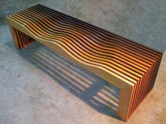 Wave bench in recycled burma teak for a bespoke residence