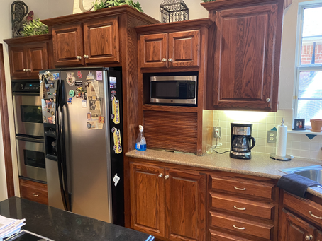 Refresh stained-wood kitchen cabinets