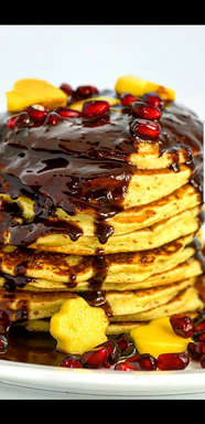 Shot of Chocoate Sauce on Pancakes