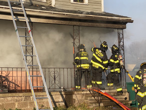 House fire with people trapped  on Lyell Avenue next to fire department