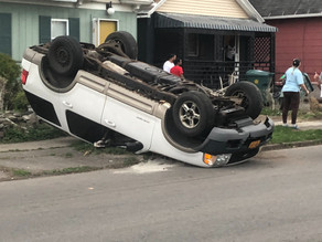 Car flipped over on Avenue D at Remington Street