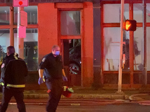 A man was hospitalized with minor injuries after his car crashed into a building