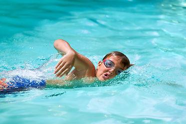 Close up of young boy at swimming practi