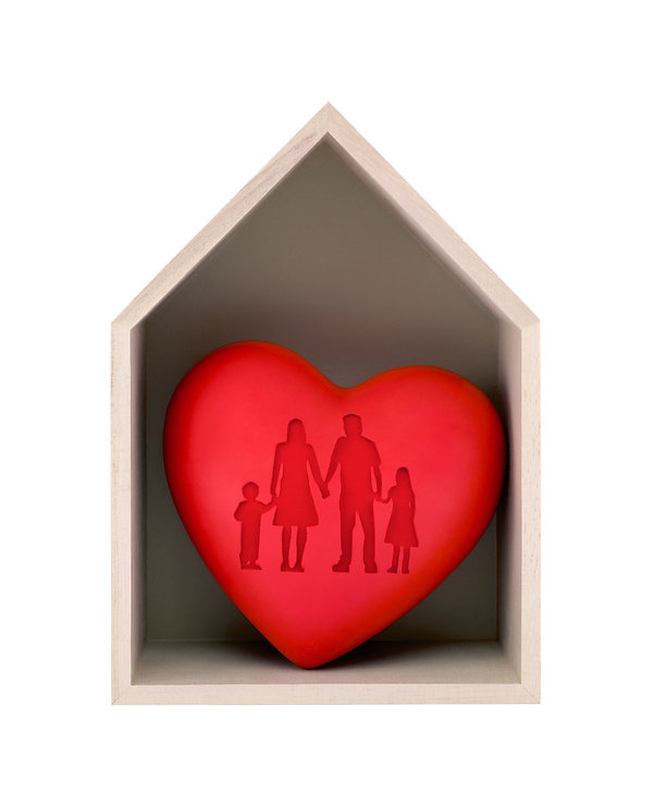 Wooden house and red heart with imprinte