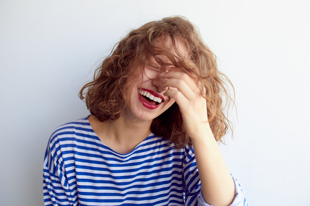 Laughing woman in marine shirt with curl