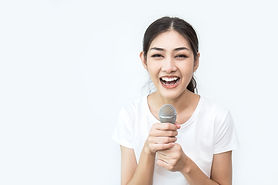 Pretty asian girl with the microphone in