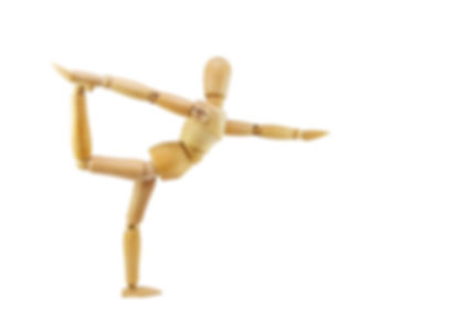 Wooden mannequin Do yoga exercises as an